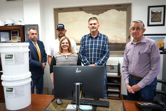 Mayor Janway and City Administrator John Lowe are pictured with David Tannehill, Dylan Magby and Lisa Gadbury.