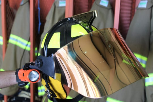 Four Corners Regional Airport showcases its new fire and rescue safety gear, seen here on Monday, May 4, 2020, in Farmington, which it received through a $37,500 federal grant. The gear includes new $275 helmets and $150 face shields for the helmets.