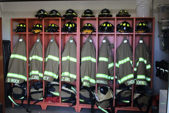 Four Corners Regional Airport showcases its new fire and rescue safety gear, seen here on Monday, May 4, 2020, in Farmington, which it received through a $37,500 federal grant. The gear includes new $275 helmets and $1,300 coats.