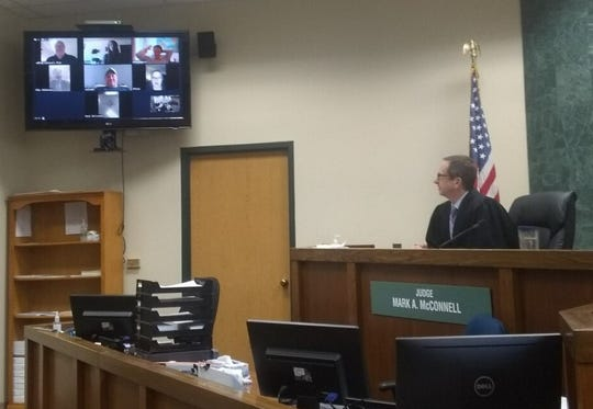 Westland's 18th District Judge Mark McConnell has been using Zoom's video conferencing services and YouTube's live streaming capabilities to conduct court hearings during the pandemic. Here, he is participating in a sobriety court staff meeting.