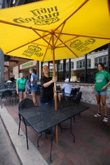 The staff of Cactus Cantina prepares its outdoor seating on Monday ahead of the lunch rush.