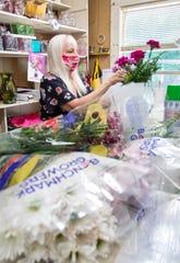 A Flower Shop co-owner Keri Hankins creates a fresh flower arrangement Monday.