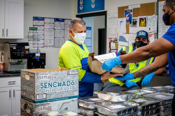 A Republic Services driver receives a free family meal, which happens each Friday, provided by Republic Services for their front-line employees on May 1, 2020 in Mesa.