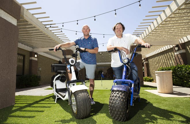 Peter Johnson and Beau Ralphs (right) owners of Phat Scooters in Tempe. During the coronavirus pandemic Phat Scooters donated a dozen scooters to local restaurants to use for delivery services.