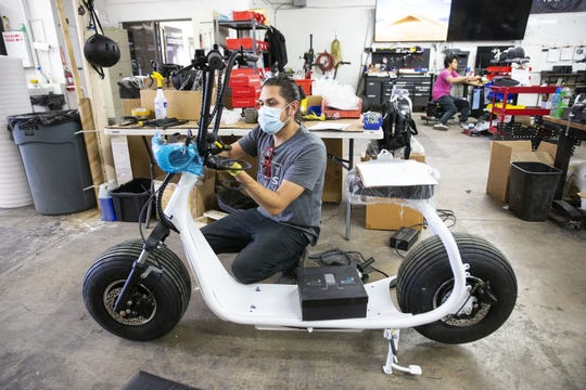 Phat Scooters technician Thomas Ruiz assembles a scooter at the Tempe office. During the coronavirus pandemic Phat Scooters donated a dozen scooters to local restaurants to use for delivery services.