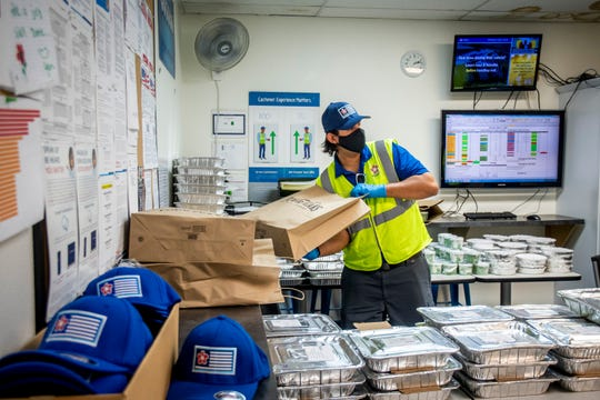 Republic Services industrial operations supervisor Justin Sharma readies a family meal provided by Republic Services for a front-line employee, which happens every Friday, on May 1, 2020 in Mesa.