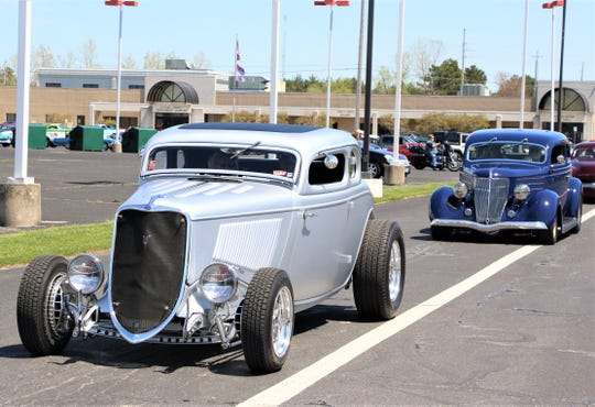 """The men and women of the Erie Shore Cruisers Car Club held a """"Honk-About"""" parade on Sunday with over 150 vehicles traveling through the streets of Port Clinton."""