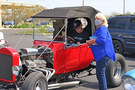 """Members of the the Erie Shore Cruisers Car Club prepare for Sunday's """"Honk-About"""" parade on Sunday, taking their show cars to the street instead of a parking lot."""