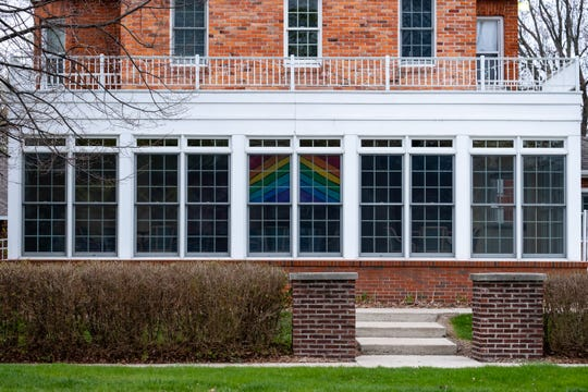 Windows at the Sanborn Gratiot Memorial Home are seen decorated with a painted rainbow Monday, May 4, 2020, in Port Huron. This year, instead of an annual luncheon, the memorial home is holding their fundraiser online.