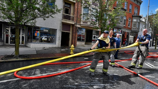 Four adults have been displaced by a fire in the 300 block of West Market Street, Monday, May 4, 2020. According to York City Fire Chief Chad Deardorff, it is suspected that the fire started outside the building due to discarded smoking items, and traveled up the wall through four floors. Red Cross is assisting the displaced.
