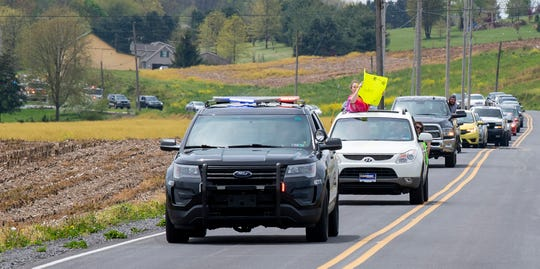 About 50 cars, led by a police cruiser, make their way along  Century Farms Road in East Hopewell township as they approach Patrick Maloney's home to wish him a happy birthday.