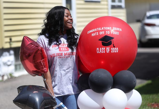 Sierra Burrows, a graduating senior at Wilson Magnet, is greeted by family and friends outside her home. Family friend Sedawnie Williams joined a Facebook Group of Senior Fairies, who choose a graduating high school senior to celebrate during the Coronavirus pandemic.