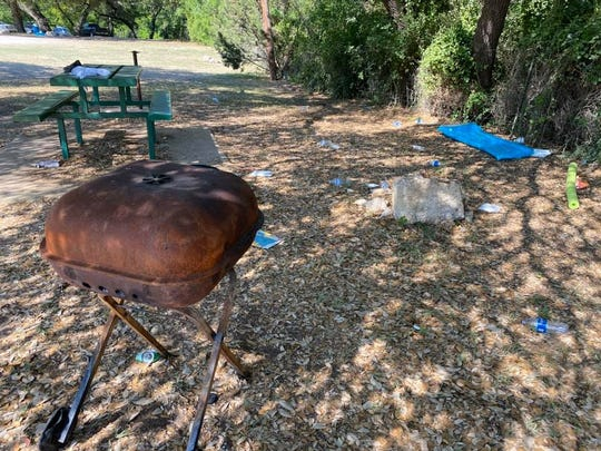 Water bottles and other waste was left in Christoval's Pugh Park Monday, after over 1,000 people visited South Concho River over the weekend.