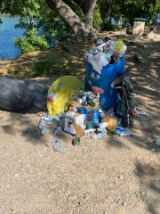 Christoval city officials discovered overflowing trash cans and litter around Pugh Park Monday, after over 1,000 people visited South Concho River over the weekend.