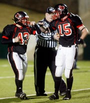 Garden City High School's Ian Schaefer (43) celebrates a touchdown with teammate Aaron Long during the 2010 state final against Throckmorton.