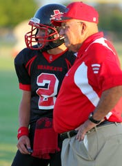Garden City head coach Vance Jones and Blayne Batla talk things over during a 2011 game against Sterling City.