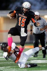 Robert Lee's Will Howard tries to dodge a tackle by Garden City's Isaiah Enriquez during a game in 2013.