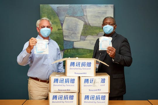 David Raines Community Health Centers is among the healthcare settings receiving masks from Tencent's donation to BRF. Pictured: BRF President and CEO John F. George Jr., M.D., and David Raines Community Health Centers CEO Willie C. White.