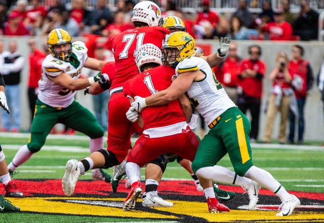 Derrek Tuszka (right) makes a tackle at Illinois State last season.
