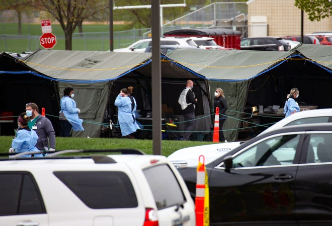 Healthcare workers run a coronavirus testing site for Smithfield employees in the Washington High School parking lot on Monday, May 4, in Sioux Falls.