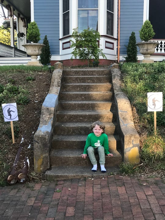 """Kelly Morse, who lives on Church Street in Staunton, put up a sign in her yard letting pedestrians know they were entering the """"Jurisdiction of Silly Walks."""" Many passersby have shown off their silliest walks, which she has captured on her video camera."""
