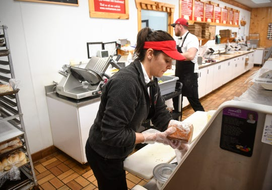 Kristi Murray prepares an order for a customer while working at Von Hanson's Meat Market Monday, May 4, 2020 in Waite Park.
