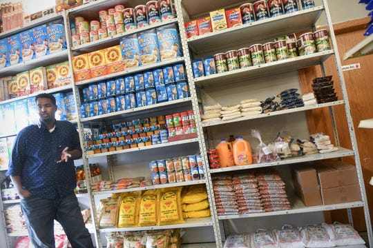 Noor Yussuf  talks about packages of halal food available for those in need  Monday, May 4, 2020, at Midnimo Grocery & Halal Meat in St. Cloud.