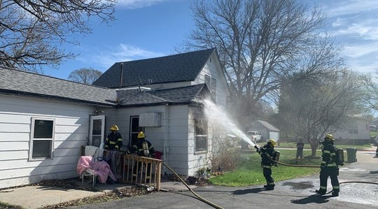 The Kimball Fire Department extinguishes a fire at 31 Elm Street South in Kimball the morning of Saturday, May 2, 2020.