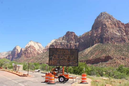 Street sign outside of Zion National Park. The park plans to reopen after being closed for over a month.