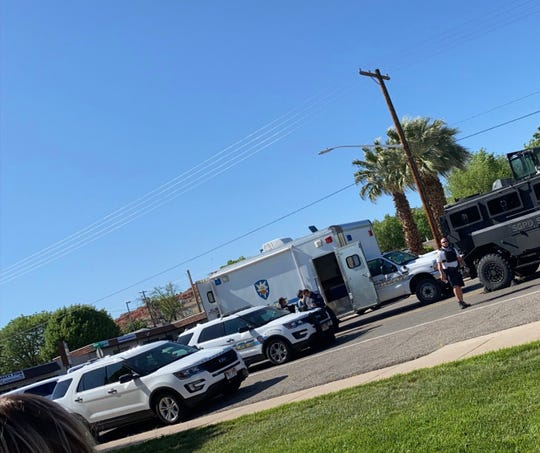 In this photo taken by a Vintage Tabernacle Apartments resident, police are seen responding to reports that Dmytro Luke, 21, fired a gun inside a student housing complex just off of Dixie State University's campus.