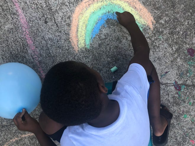 Sunshine graced both sky and sidewalk in Talethia Edwards' neighborhood during their Chalk The Walk event at the end of March.