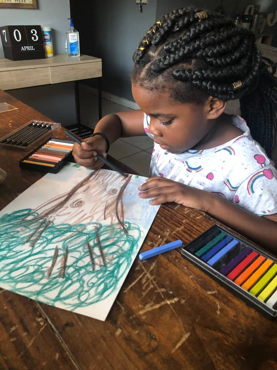 Talethia Edwards has found home art activities keep her children engaged.