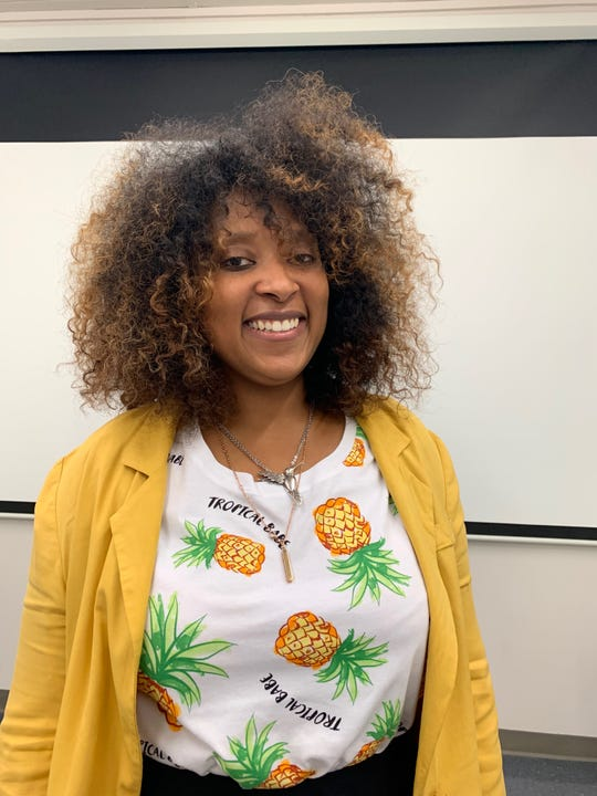 April Fitzpatrick, the founder of Pineapples with Purpose, blends her background in psychology with art to facilitate healing in trauma-focused workshops.