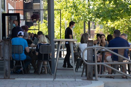 Madison Social's patio area is filled with customers during the restaurant's first day back open for seated service Monday, May 4, 2020.
