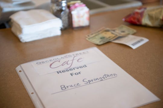 """Catherine Sharpe, owner of Osceola Street Cafe, placed reserved signs for celebrities across the restaurant to help maintain the 25% occupancy rule set in place by the governor starting Monday, May 4, 2020, at the restaurant in downtown Stuart. Sharpe and her family came up with the idea to make the """"reservations"""" for celebrities like Bruce Springsteen, Jennifer Lopez, Walt Disney, Michael Jordan and Tiger Woods."""