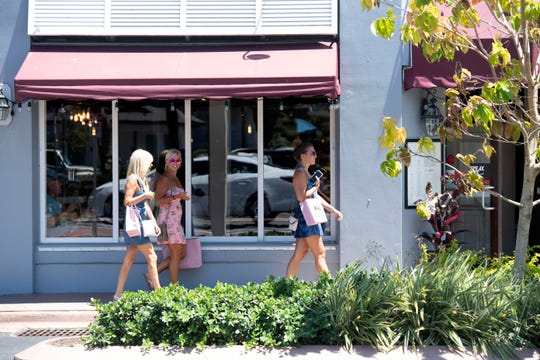 """Some businesses reopened Monday, May 4, 2020, in downtown Stuart. To help stop the spread of coronavirus, Gov. Ron DeSantis issued an executive order prohibiting dining at restaurants and closing non-essential retail stores April 1, but retail stores and restaurants in Stuart were able to open Monday at 25% capacity under """"Phase 1"""" of the governor's reopening plan for Florida."""