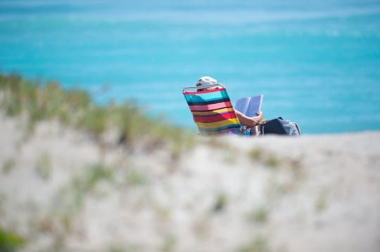 An estimated 1,000 people spread out on Stuart Beach on the first day beachgoers were able to access Martin County beaches on Monday, May 4, 2020 on Hutchinson Island. Martin County commissioners voted to reopen the beaches, excluding Hobe Sound Beach and Bathtub Reef Beach, but said they need to follow the CDC's guidelines for social distancing, including staying 6 feet apart from strangers.