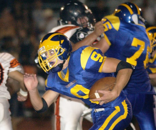 Exeter's Cameron Loeffler runs against Woodlake High School in the second quarter during a 2006 game.