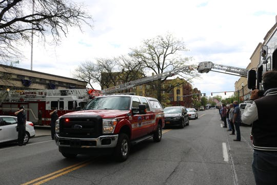 New Rochelle Fire Department Captain Andrew DiMaggio's procession past New Rochelle Fire Department Station 1 on May 4, 2020. He died of COVID-19 Sunday.