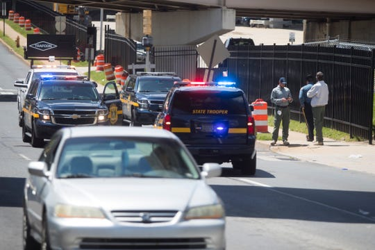 Delaware State Police were on scene at North Adams Street investigating a fatal crash where a motorcyclist fell over the side of the Interstate 95 on-ramp from Martin Luther King Boulevard.