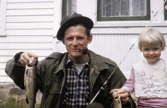 A younger Jerry Apps along with his daughter Sue proudly show off a recently caught trout.