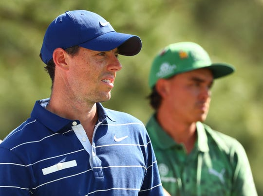 Rory McIlroy (left) and Rickie Fowler on the 18th tee during the first round of The Masters at Augusta National Golf Club.