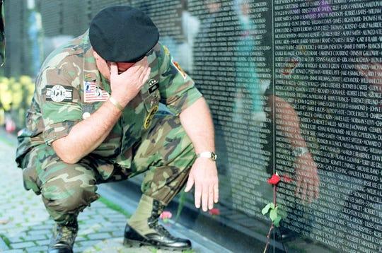 Veteran at the Vietnam Veterans Memorial wall on June 8, 2000.