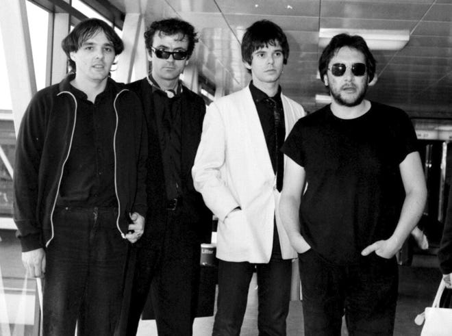 Dave Greenfield, the keyboard player with British punk band The Stranglers (pictured far left in this 1980 photo), has died after testing positive for coronavirus. He was 71. The band's official website announced that Greenfield died on Sunday, May 3, 2020 after contracting the virus following a stay in hospital for heart problems.