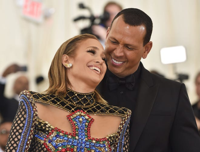 Jennifer Lopez and Alex Rodriguez arrive for the 2018 Met Gala. (Photo by Hector RETAMAL / AFP)
