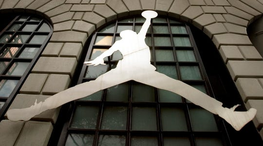 The famous Nike Michael Jordan image graces the front of the Niketown store in downtown Portland, Ore.