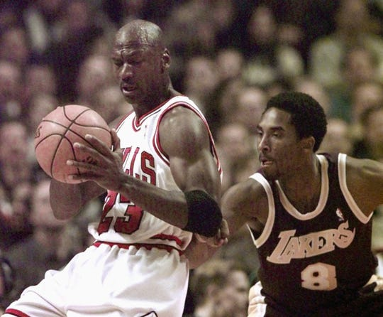 Michael Jordan is defended by Kobe Bryant during a Dec. 17, 1997 game.