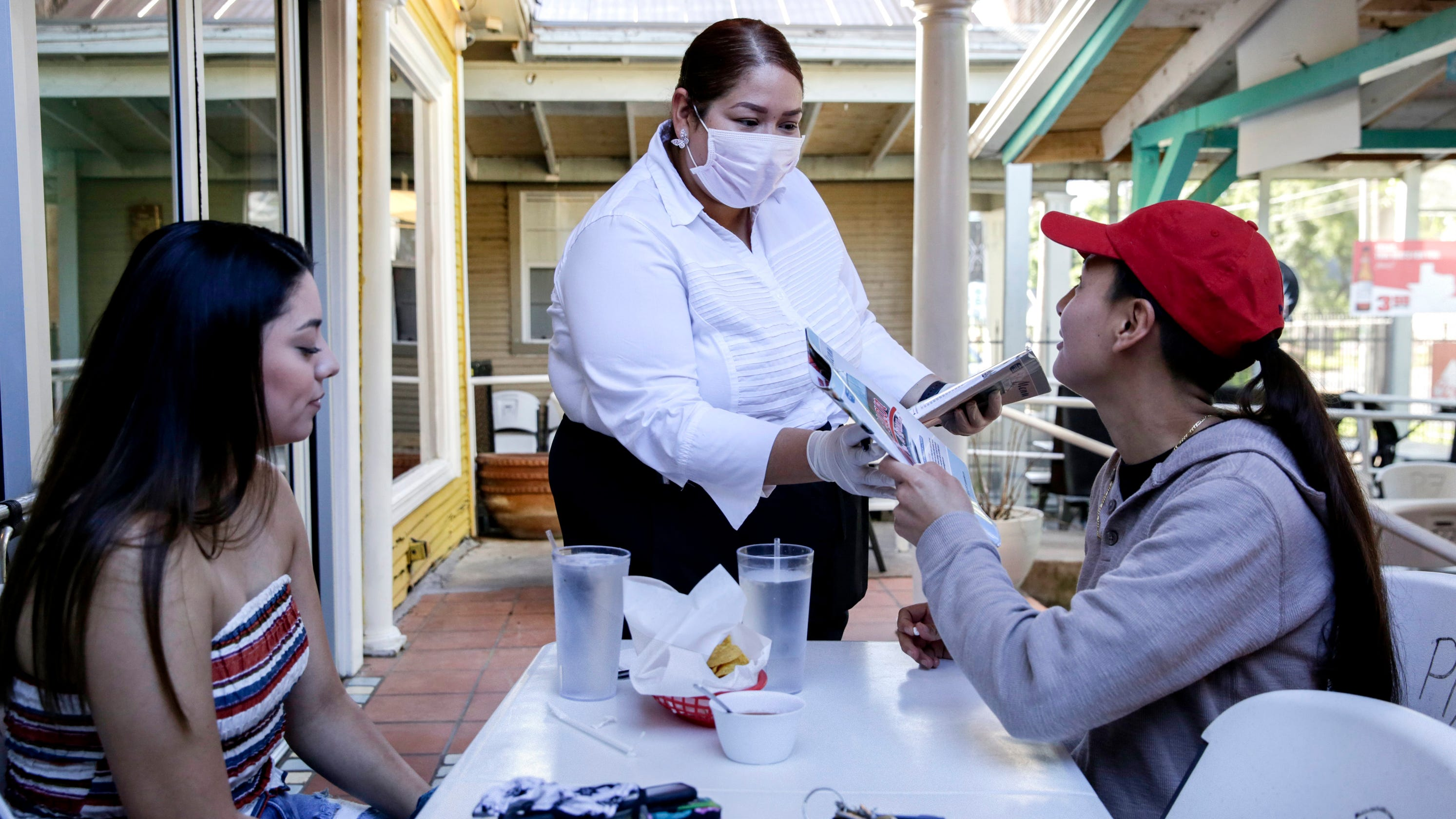 Across US, a 'tale of two cities' as some embrace reopening amid coronavirus and others remain wary