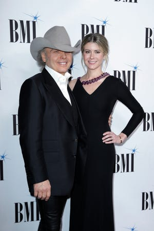 Dwight Yoakam and Emily Joyce married in March just prior to the quarantine in a private ceremony at St Monica Catholic Church in Santa Monica, Calif. This photo of the couple is from Nov. 12, 2019.