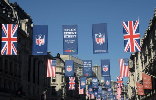 General overall view of British and United States flags and NFL shield logo banners on Regent Street.